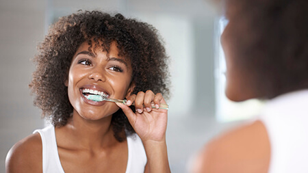 Lake Forest preventive dentistry woman brushing teeth